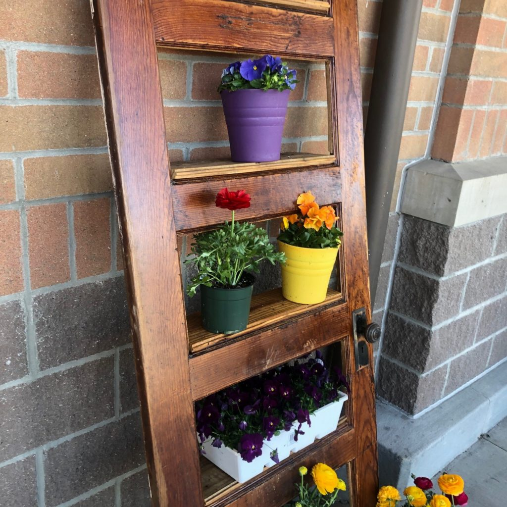 Leaning Door Shelf decorated with plants detail view