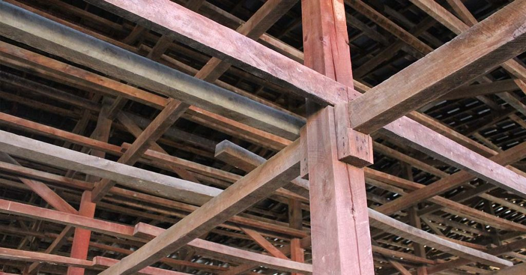 Cross beams inside the wooden barn